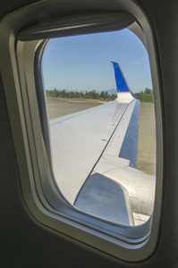 Left wing view from passenger window